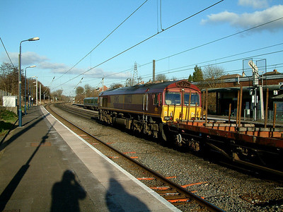 66023 hurries past Longbridge on the 26th January 2006
