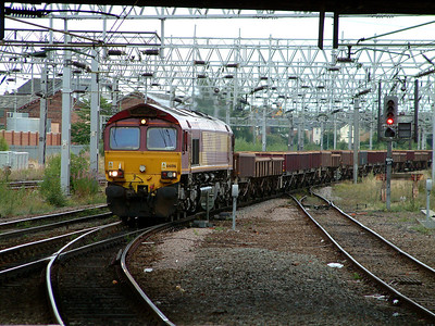 66016 rumbles through Stafford with a spoil train on the 12th August 2006