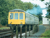 Class 119 2 Car DMU set number P571 departs Coombe Junction with a Liskeard to Looe service.<br /> 12th September 1980