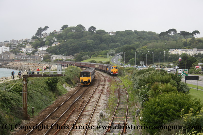 """Class 150 2 Car Sprinter DMU number 150 127 approaches Penzance with 2C45 0928 Exeter St Davids to Penzance, passing Class 20 Diesel Locomotives numbers 20 308 and 20 309 which had earlier arrived with 1Z37 0607 Gloucester to Penzance """"Kernow Voyager"""" operated by Spitfire Tours. <br /> 25th June 2011"""