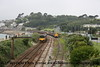 "Class 150 2 Car Sprinter DMU number 150 127 approaches Penzance with 2C45 0928 Exeter St Davids to Penzance, passing Class 20 Diesel Locomotives numbers 20 308 and 20 309 which had earlier arrived with 1Z37 0607 Gloucester to Penzance ""Kernow Voyager"" operated by Spitfire Tours. <br /> 25th June 2011"