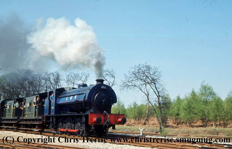 "Hunslet Austerity 0-6-0 Steam Locomotive number 196 is seen on the Longmoor Military Railway at Longmoor Downs. Previously number 68011 in BR use, the locomotive would be named ""Errol Lonsdale"".<br />  30th April 1966"