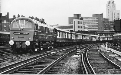 "Class 71 Electric Locomotive number E5015 with the ""Golden Arrow"" Pullman service departs London Victoria.  Official BR Publicity photograph supplied with thanks by Mr G Holmes.<br /> 12.06.61"