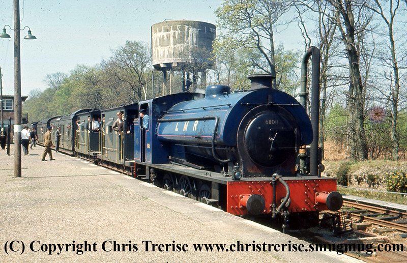 """Hunslet Austerity 0-6-0 Steam Locomotive number 196 is seen on the Longmoor Military Railway at Longmoor Downs.  Previously number 68011 in BR use, the locomotive would be named """"Errol Lonsdale"""".<br /> 30th April 1966"""