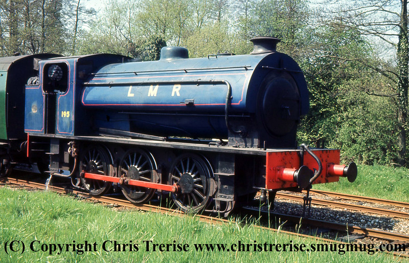 Hunslet Austerity 0-6-0 Steam Locomotive number 195 is seen on the Longmoor Military Railway at Longmoor Downs. <br />  30th April 1966