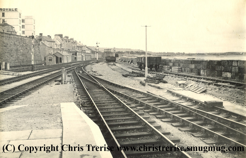 "Penzance station showing work in progress during rebuilding work to extend the number of platforms. The photograph is stamped on the rear ""GWR Chief Engineer's Office Paddington Photographic Department"".<br /> 14th August 1940"