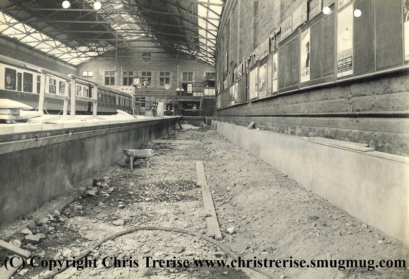 "Penzance station showing work in progress during rebuilding work to extend the number of platforms. This shows work in progress towards the buffer stops at Platform 1.  The photograph is stamped on the rear ""GWR Chief Engineer's Office Paddington Photographic Department"".<br /> 14th August 1940"