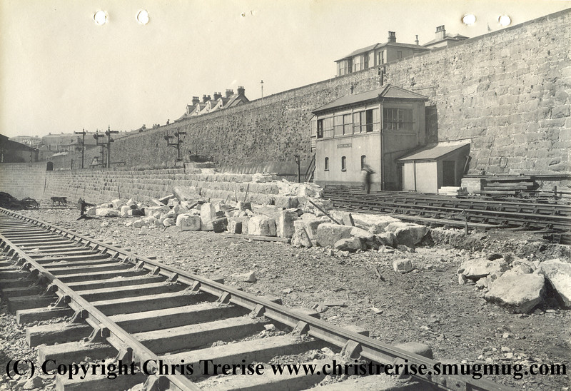 "Penzance station showing work in progress during rebuilding work to extend the number of platforms. The photograph is stamped on the rear ""GWR Chief Engineer's Office Paddington Photographic Department"".<br /> 12th April 1938"