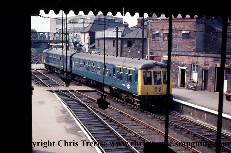 Class 114 2 Car DMU enters Grimsby Town station with a Cleethorpes service as viewed from the station footbridge.<br /> 2nd August 1973