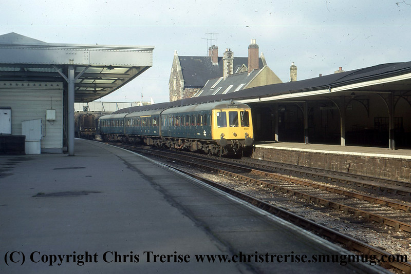 Class 116 3 Car DMU Set number P322 is seen at Barnstaple with a Paignton service.  A Class 08 Diesel Shunter can be seen to the left.<br /> 18th February 1973