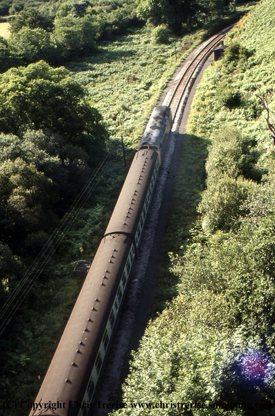 D8xx Warship Diesel Locomotive passes under Treffry Viaduct with a Newquay service.<br /> 1974