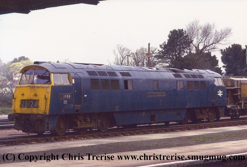 """Class 52 Western Diesel Hydraulic Locomotive number D1059 named """"Western Empire"""" at Truo with the Chacewater cement wagons.<br /> April 1974"""