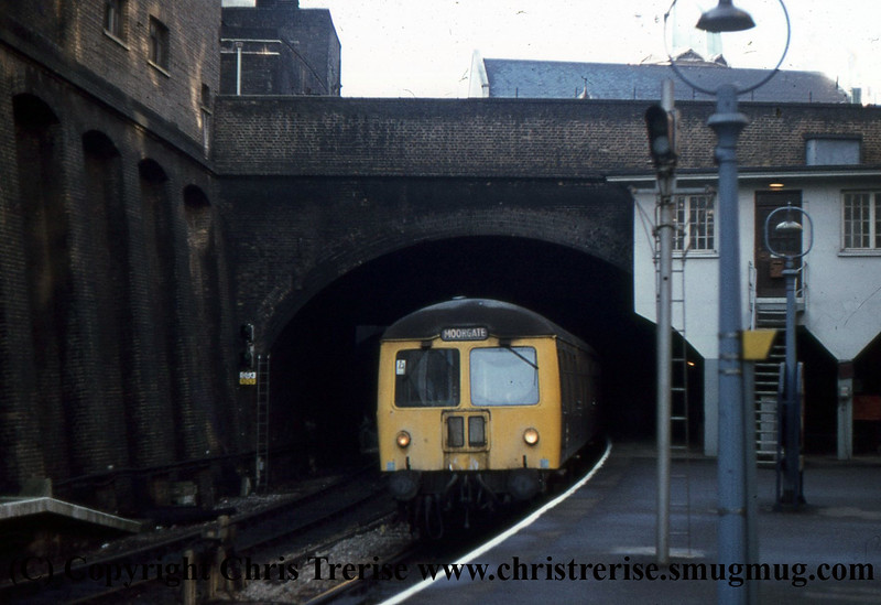 A Class 105 DMU Set enters Barbican station with a Moorgate service.<br /> January 1976