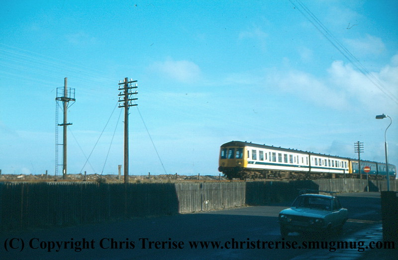 A pair of Class 114 DMUs pass Blundell Park with the 1318 Newark to Cleethorpes.<br /> 6th February 1979