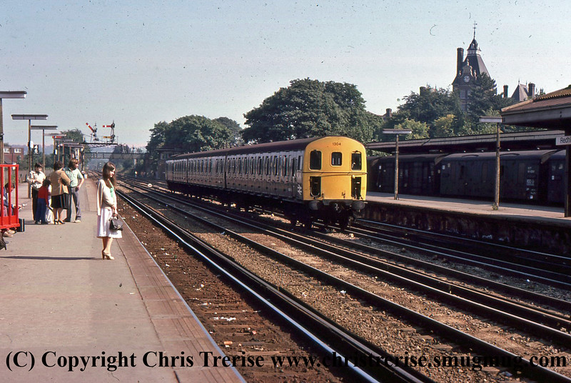 Class 207 3 Car DEMU number 1304 passes Redhill with an empty stock working.<br /> September 1979
