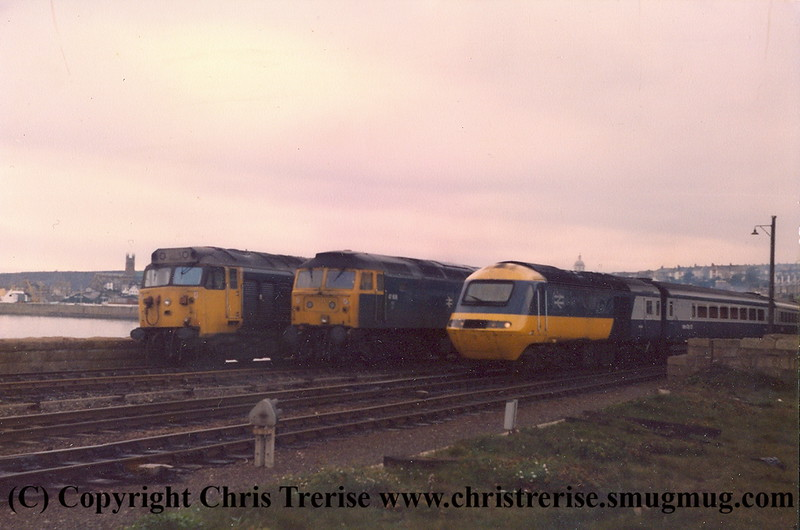 "Sunday morning at Penzance in 1984.  I failed to record the actual date.  An HST departs for up-country.  By the use of a magnifying class I have since been able to identify the Class 47 Diesel Locomotive as 47 606 named ""Odin"""