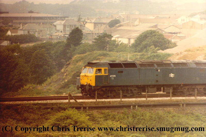 Class 47 Diesel Locomotive number 47 575 at Brea Village approaching Camborne.<br /> 1984