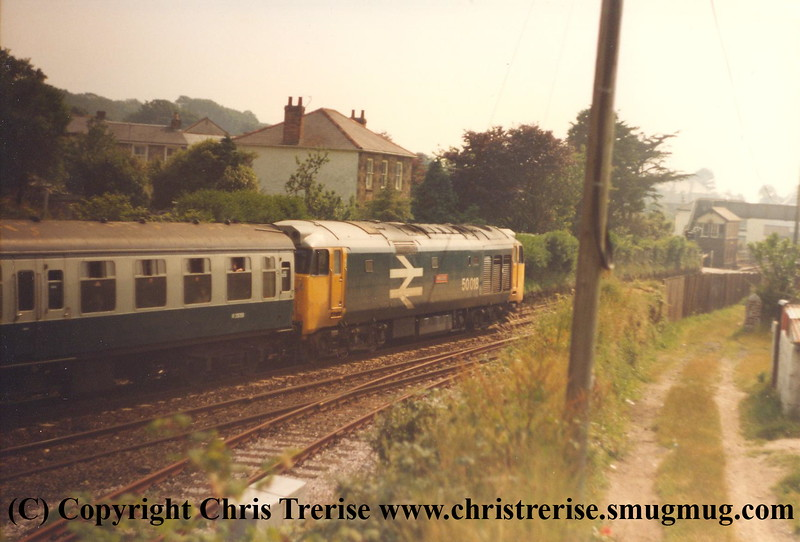 """Class 50 Diesel Locomotive number 50 018 named """"Resolution"""" passes Roskear Junction with a Penzance service.  Roskear Signal Box canbe seen in the distance. <br /> 1984."""