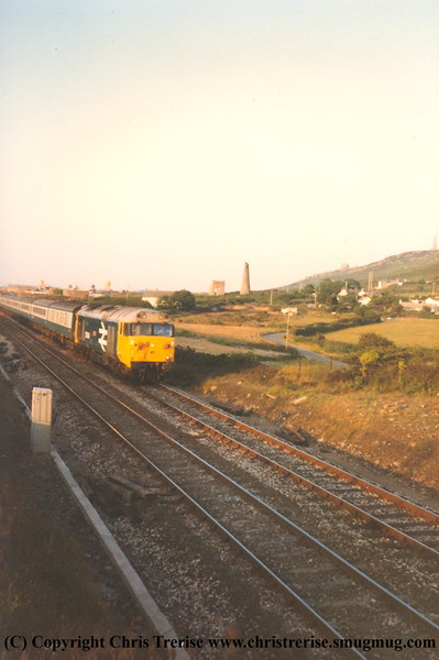 Unidentified Class 50 approaches Dolcoath Siding with a Penzance bound service in 1984.