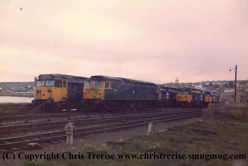 """Sunday morning at Penzance.  Five Class 50s and one Class 47.  I stupidly never recorded the numbers of the locos or the date, other than knowing it was a Sunday in 1984.  I have since been able to identify the Class 47 as 47 606 named """"Odin""""."""