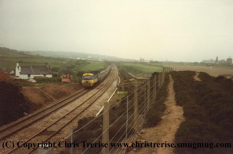 A Penzance bound Class 43 HST set passes Brea Village during 1984.