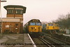 """Class 50 Diesel Locomotive number 50 009 named """"Conqueror"""" arrives at Woking with 1O12 0642 Exeter St Davids to London Waterloo.  I failed to record the identity of the Class 73 or Class 33.<br /> 15th December 1987."""