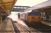 "Class 50 Diesel Locomotive number 50 031 named ""Hood"" passes Haslemere with 1P28 1530 Portsmouth Harbour to London Waterloo.  Ballast dust from the recently relaid track makes Senior Railman Bill Leahy run for cover!<br /> 13th April 1988"