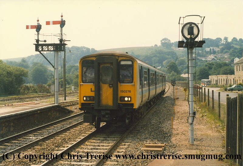 Class 150 2 Car DMU number 150 276 arrives at Lostwithiel with the 1139 Penzance to Plymouth.<br /> 15th June 1989