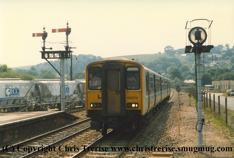 Class 150 2 Car DMU number 150 273 arrives at Lostwithiel with the 1250 Penzance to Plymouth.<br /> 15th June 1989