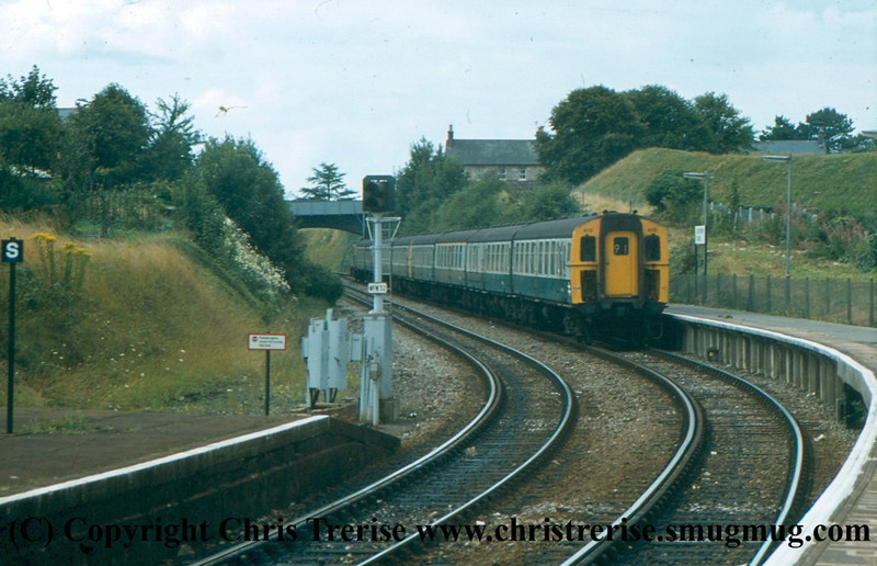 Class 438 4-TC Unit number 410 is propelled into Dorchester South by Class 33 Diesel Locomotive number 33 112 with 4-TC number 409 sandwiched between on a Weymouth to London Waterloo service.  <br /> August 1981