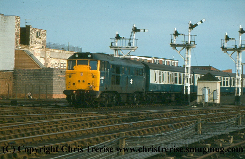 Class 31 Diesel Locomotive number 31 407 departs Cleethorpes with 2D57 1714 to Newark.<br /> 2nd April 1983