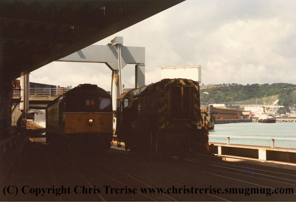 Class 33/2 Diesel Locomotive number 33 206 and Class 09 Diesel Shunter 09 020 at Dover Western Docks on the link span to the Nord Pas De Calais Train Ferry.<br /> 3rd August 1993
