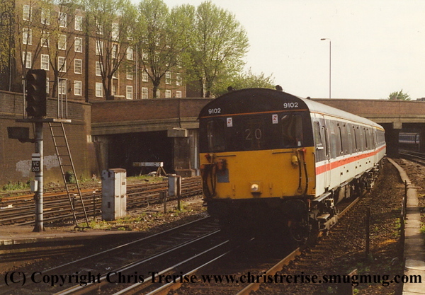 Class 489 GLV number 9102 passes Clapham Junction with a Gatwick Airport to London Victoria Gatwick Express service.<br /> 7th May 1993