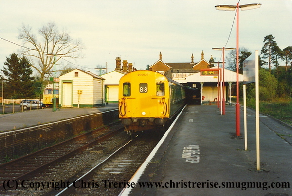 """Class 205 3 Car Thumper DEMU number 205 029 at Eridge with the 1922 Uckfield to East Grinstead.  Class 50 Diesel Locomotive number 50 019 named """"Ramilies"""" can be just seen behind the station building.<br /> 28th April 1994"""