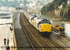 A pair of Class 37 Diesel Locomotives pass through Dawlish with the Silver Bullet china clay slurry working to Irvine.  I failed to record the numbers or the date.<br /> 1995
