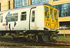 Class 319 4 Car EMU number 319 040 at St Albans Centre Siding.  Following a derailment the unit was re-railed but onto the check rails in error!<br /> March 1996