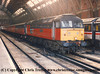 "Class 47 Diesel Locomotive number 47 736 named ""Cambridge Traction and Rolling Stock Depot"" with the stock of 1E47 2230 London St Pancras to Newcastle Travelling Post Office.<br /> 6th February 1995"