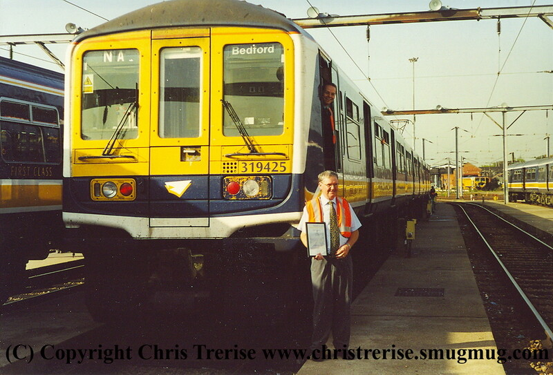 Class 319/4 4 Car EMU Set number 319 425 at Bedford Carriage Sidings.  Neville Ankers displays his 40 year service certificate and Richard Dean looks on from the cab.  Note the appropriate headcode,<br /> October 2001