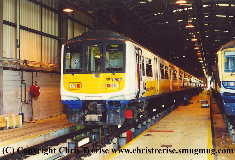 Class 319/0 4 Car EMU Set number 319 011 at Selhurst Depot.<br /> 5th October 2001
