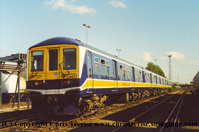 Class 319 4 Car EMU number 319 423 at Selhurst Depot.  Freshly painted but minus CityFlier branding.<br /> 5th October 2001
