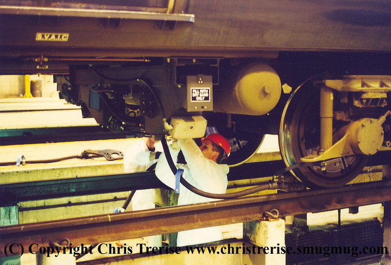 Sanding equipment being fitted to Class 319 EMU number 319 369, a project that I was responsible for.<br /> 5th October 2001