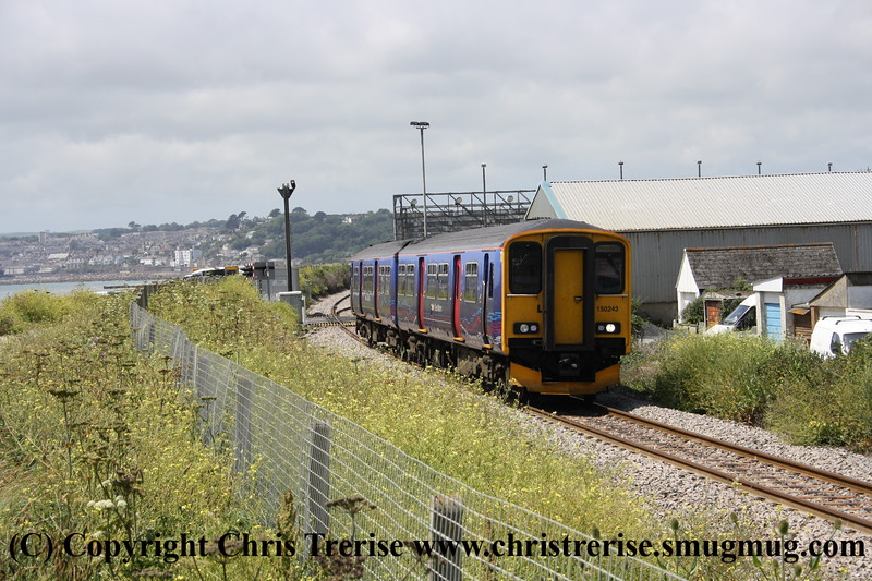 Class 150 2 Car Sprinter DMU number 150 243 passes Long Rock with the 1254 Penzance to Plymouth.<br /> 27th June 2009