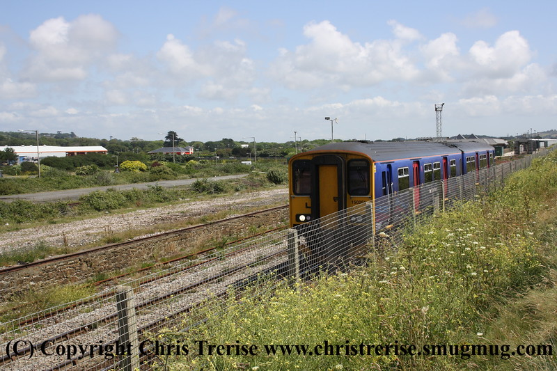 Class 150 2 Car Sprinter DMU number 150 261 passes Ponsandane with the 0934 Exeter St Davids to Penzance.<br /> 27th June 2009