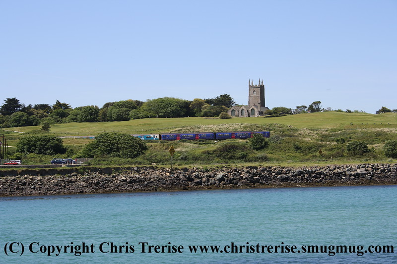 Class 150 2 Car Sprinter DMU number 150 280 leads 150 233 past St Uny's Church with the 1125 St Ives to St Erth.<br /> 30th May 2009