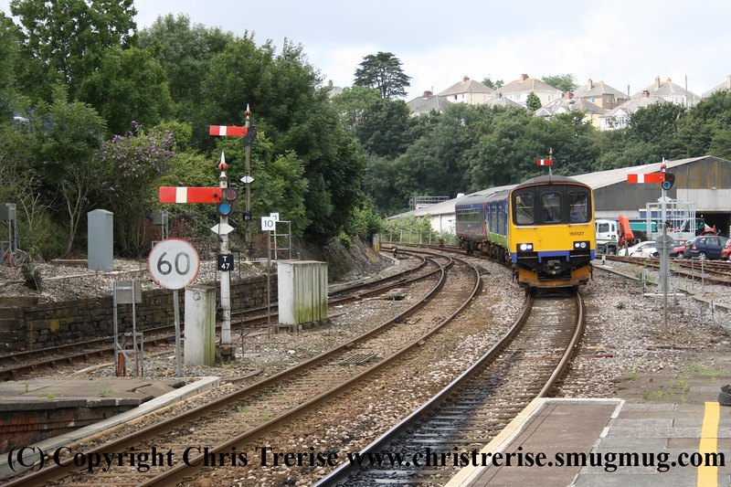 Class 150 2 Car Sprinter DMU number 150 127 attached to Class 153 Single Car DMU number 153 372 approaches Truro with the 1145 Penzance to Paignton.<br /> 22nd July 2009