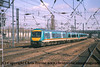 Class 170 2 Car DMU number 170 115 at the rear of a Leeds service departing Doncaster with an unidentified Class 170 leading.<br /> 21st April 2001