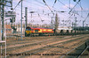Class 66 Diesel Locomotive number 66 085 passes Doncaster with MGR Hopper Wagons on a coal working.<br /> 21st April 2001