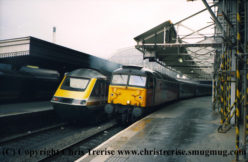 "Class 47/7 Diesel Locomotive number 47 726 named ""Manchester Airport Progress"" at London Paddington.<br /> 9th June 2001"