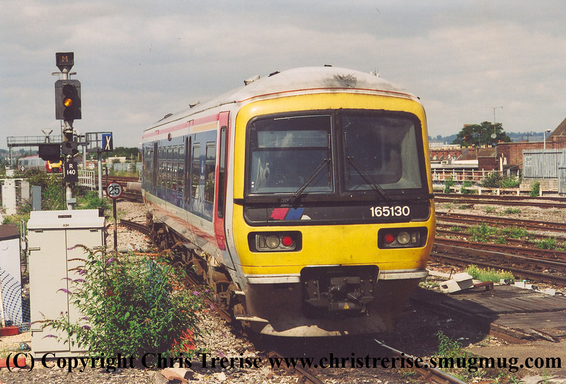 Class 165 3 Car DMU number 165 130 departs Reading with an Oxford service.<br /> 4th April 2003