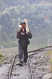 Miner walks to the adit at Qidianzhan